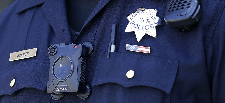 San Francisco Police officer Joe Juarez wears a body camera while patrolling outside of AT&T Park before a baseball game.