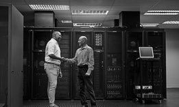 Shot of two men shaking hands in a data center