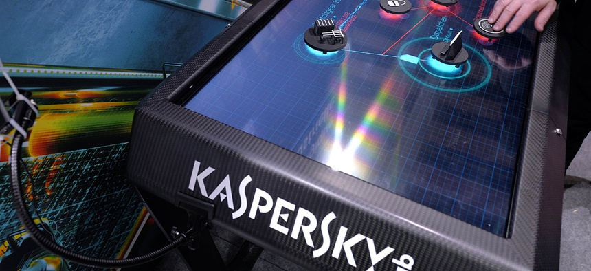 A man uses an electronic demonstration table at the Kaspersky Lab stand during the International Cybersecurity forum in Lille, northern France, Tuesday Jan. 23, 2018.