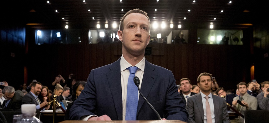 Facebook CEO Mark Zuckerberg arrives to testify before a joint hearing of the Commerce and Judiciary Committees on Capitol Hill in Washington, Tuesday, April 10, 2018.
