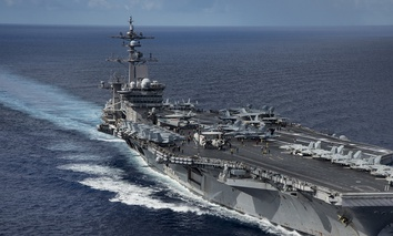 The Nimitz-class aircraft carrier USS Carl Vinson transits the Philippine Sea