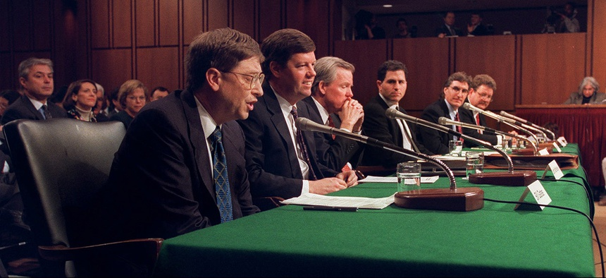 Microsoft President Bill Gates, left, and other software industry executives testify on Capitol Hill, Tuesday, March 3, 1998.