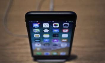 An Apple iPhone X on display during an Apple event at their main store Tuesday, March 27, 2018, in Chicago.