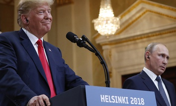 U.S. President Donald Trump, left, smiles beside Russian President Vladimir Putin during a press conference after their meeting at the Presidential Palace in Helsinki, Finland, Monday, July 16, 2018.