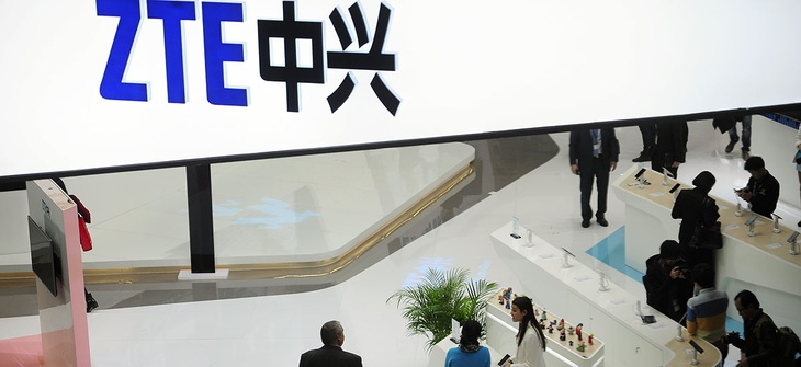 People gather at the ZTE booth at the Mobile World Congress.