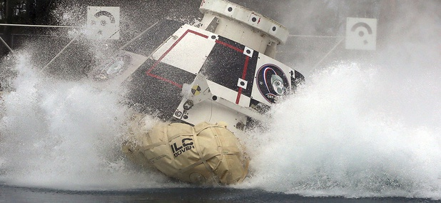A mock-up of Boeing's CST-100 Starliner splashes down in 2016.