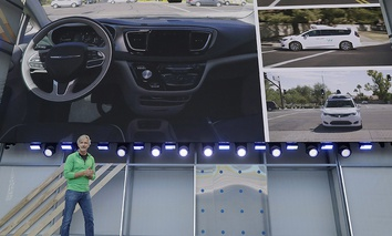 Waymo CEO John Krafcik speaks at the Google I/O conference in Mountain View, Calif., Tuesday, May 8, 2018.