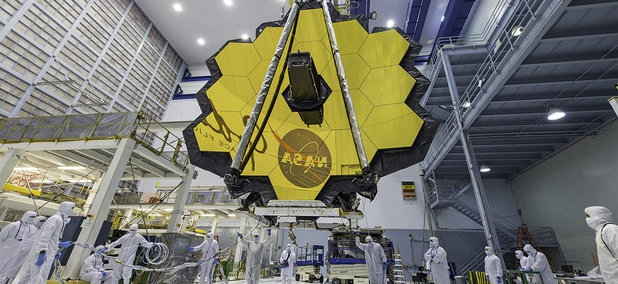 Technicians lift the mirror of the James Webb Space Telescope using a crane at the Goddard Space Flight Center in Greenbelt, Md.