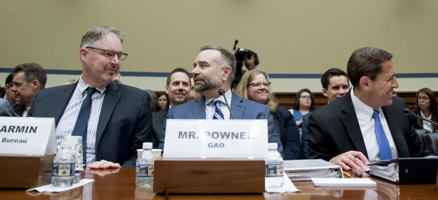 GAO's Information Technology Management Issues Director Dave Powner (center) arrive to testify at a House Oversight and Government Reform Committee hearing on the 2020 Census May 8.