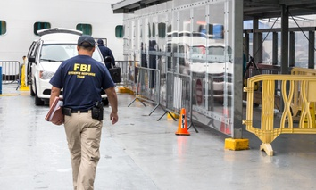 An FBI officer goes inside the Emerald Princess Cruise Ship docked in Juneau, Alaska, to investigate a crime.