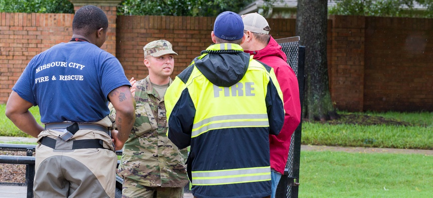Texas National Guard and first responders working together to assist with emergency operations. Heavy rains from hurricane Harvey caused many floods near Houston Aug. 29, 2017.
