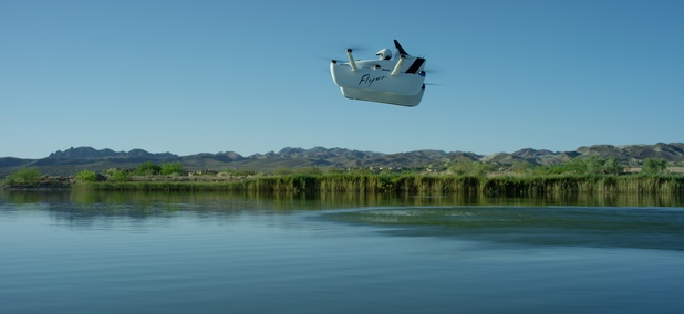 A Flyer personal aircraft cruises above a body of water.