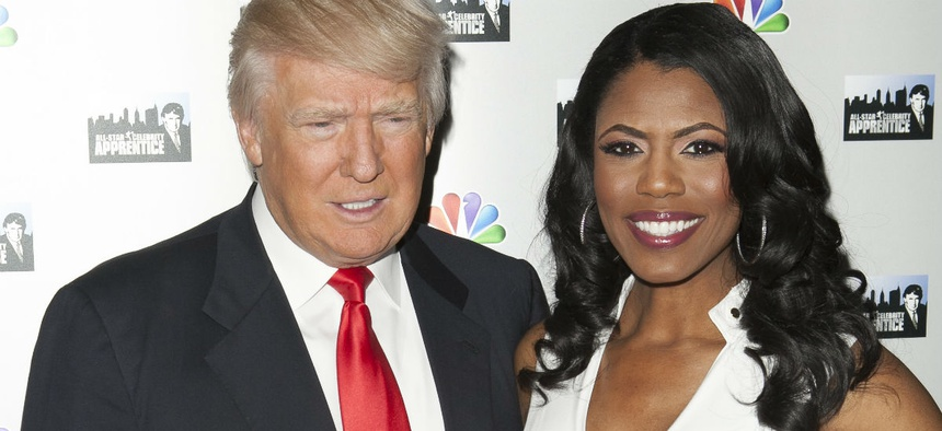 Donald Trump and Omarosa Manigault attend the 'All-Star Celebrity Apprentice' Red Carpet Event at Trump Tower on April 1, 2013 in New York City.