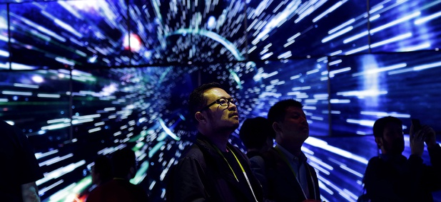 Bao Truong looks at a display of Samsung SUHD Quantum dot display TVs at the Samsung booth during CES International, Friday, Jan. 8, 2016, in Las Vegas.