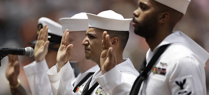 Navy sailors from the USS Makin Island take part in a re-enlistment ceremony in San Diego.