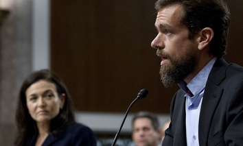 Twitter CEO Jack Dorsey, accompanied by Facebook COO Sheryl Sandberg, testify before a Senate Intelligence Committee hearing on Capitol Hill.