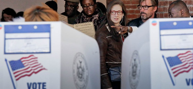 Voters are directed to empty booths to mark their ballots at the Brooklyn Museum polling site, Tuesday Nov. 8, 2016, in Brooklyn, N.Y.