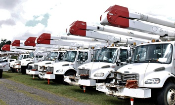 Utility trucks line up in a parking lot adjacent to Charlotte Motor Speedway in Concord, North Carolina, on Wednesday, Sept. 12, 2018.