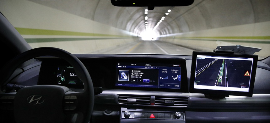 Hyundai's autonomous fuel cell electric vehicle Nexo is driven through a tunnel near the Pyeongchang Olympic Stadium in South Korea.