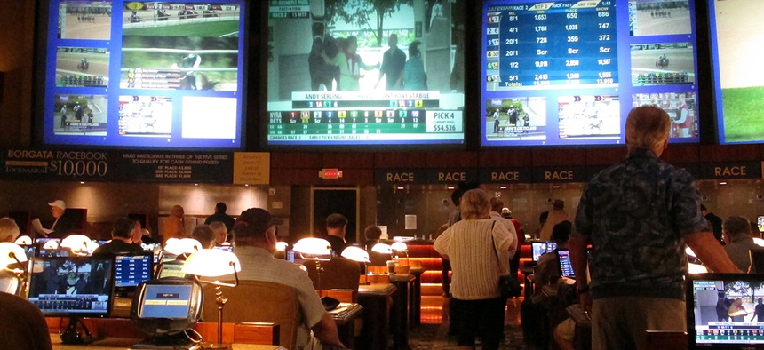 Bettors wait to make wagers on sporting events at the Borgata casino in Atlantic City, N.J.,