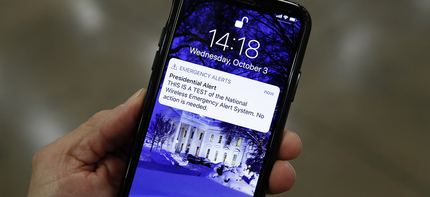 A presidential emergency alert test is seen on a phone on Capitol Hill.