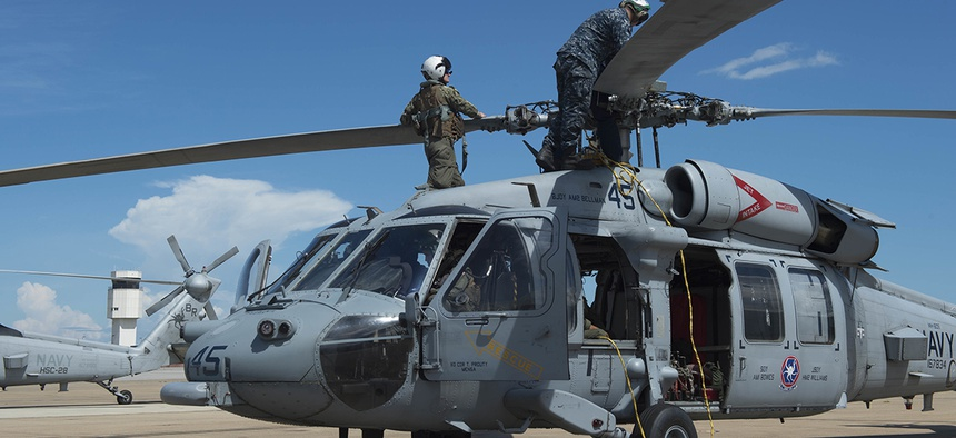 Sailors of Helicopter Sea Combat Squadron (HSC) 28 prepare MH-60S Sea Hawk helicopters.