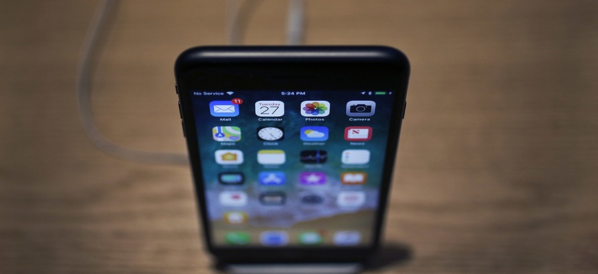 An Apple iPhone X on display during an Apple event.
