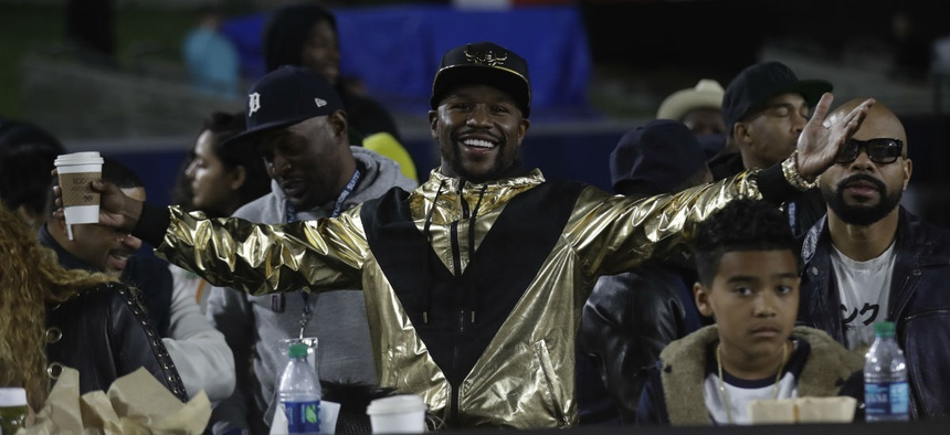 Boxer Floyd Mayweather Jr. reacts in the stands during an NFL football game Nov. 19 in Los Angeles.