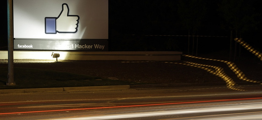 "The Facebook ""like"" symbol is on display on a sign outside the company's headquarters in Menlo Park, Calif., Friday, June 7, 2013."