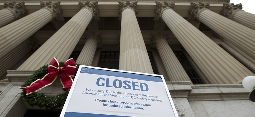 A closed sign is displayed at The National Archives entrance in Washington, Tuesday, Jan. 1, 2019, as a partial government shutdown stretches into its third week.