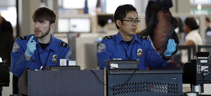 Transportation Security Administration officers work at a checkpoint at O'Hare airport in Chicago, Saturday, Jan. 5, 2019.
