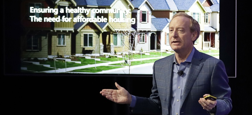 Microsoft Corp. President Brad Smith speaks Jan. 17 in Bellevue, Wash., to announce a $500 million pledge by Microsoft to develop affordable housing for low- and middle-income workers in Seattle.
