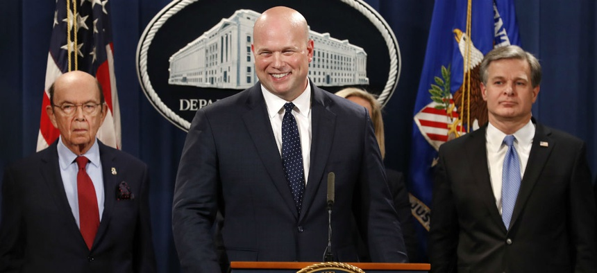 Acting Attorney General Matt Whitaker, center, announces an indictment of Chinese telecommunications companies including Huawei, on violations including bank and wire fraud Jan. 28 at the Justice Department in Washington.