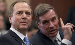 Rep. Adam Schiff, left, speaks with Sen. Mark Warner at an event marking 100 days since the death of Jamal Khashoggi on Capitol Hill Jan. 10.
