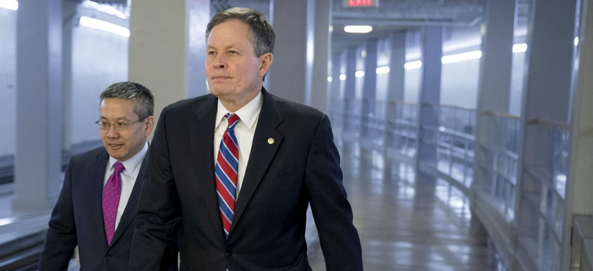 Sen. Steve Daines, R-Mont., walks through the Senate subway on Capitol Hill in Washington Jan. 9.