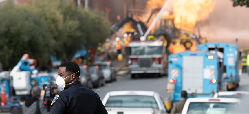 Firefighters battle a gas main blaze on Geary Blvd in San Francisco's Richmond District in February.