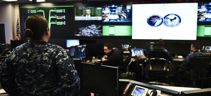 Sailors stand watch in the Fleet Operations Center at the headquarters of U.S. Fleet Cyber Command, a component of U.S. Cyber Command.