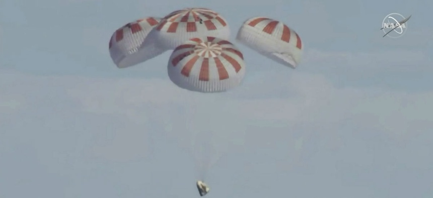 SpaceX's Dragon capsule carrying a test dummy splashed down into the Atlantic ocean off the Florida coast March 8.