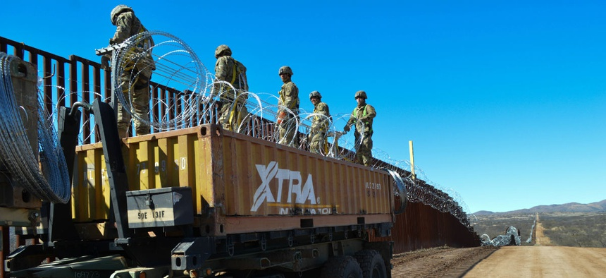 Engineers and military police welded rebar and emplaced single strand and concertina wire on the border wall in Sasabe, Arizona, in February.