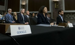 An empty chair reserved for Google's parent Alphabet, which refused to send its top executive, is seen as Facebook COO Sheryl Sandberg and Twitter CEO Jack Dorsey testify before the Senate Intelligence Committee Sept. 5.