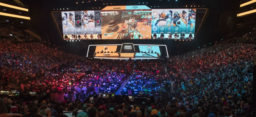 Fans watch the last July's competition between Philadelphia Fusion and London Spitfire during the Overwatch League Grand Finals competition in New York.