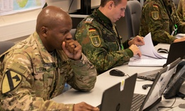 American and German soldiers work in the Tactical Operations Center at 1st German Netherlands Corps Headquarters for Trident Juncture 2018 in Norway in October.