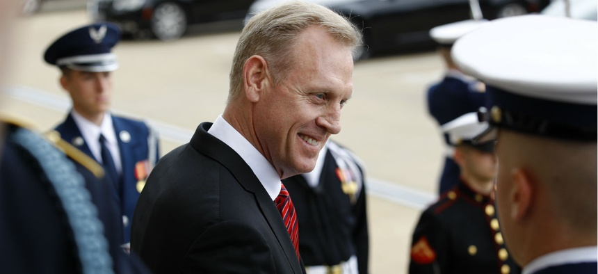 Acting Defense Secretary Patrick Shanahan speaks with reporters before an arrival ceremony for Japan's Defense Minister Takeshi Iwaya at the Pentagon April 19.