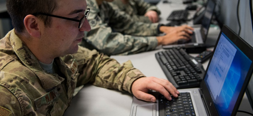 An airman troubleshoots a computer at the hub at Barksdale Air Force Base.