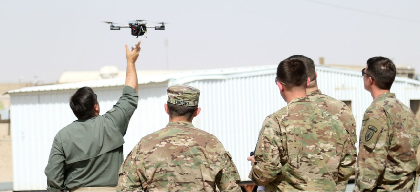 Instructors from ARCENT Readiness Training Center - Kuwait demonstrate how to launch a drone using Instant Eye technology for 1st Security Forces Assistance Brigade soldiers March 2018.