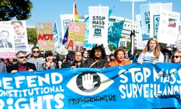 Protesters rally against mass surveillance during an event organized by the group Stop Watching Us in Washington, D.C., on Oct. 26, 2013.