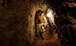 A member of the Border Patrol's Border Tunnel Entry Team walks in a tunnel spanning the border between San Diego and Tijuana, Mexico, in San Diego in 2017.