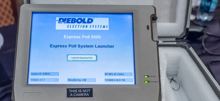 A hacked voting machine on display at DEFCON cybersecurity conference in 2017.