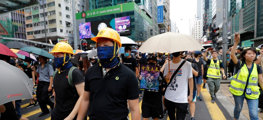Protestors march through the Mong Kok neighborhood during a demonstration in Hong Kong, Aug. 3, 2019.