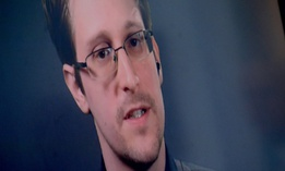 In 2016, Edward Snowden via video from Moscow speaks at the launch of a campaign calling on President Obama to pardon him.